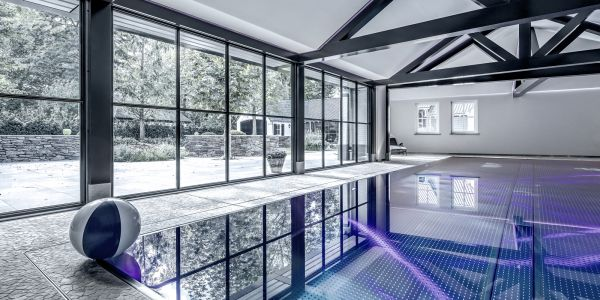 Stainless-steel pool and electrically operated window in floor